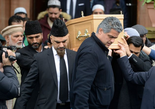 Mourners carry the coffin of Asad Shah at the Bait Ur Rahman Mosque on April