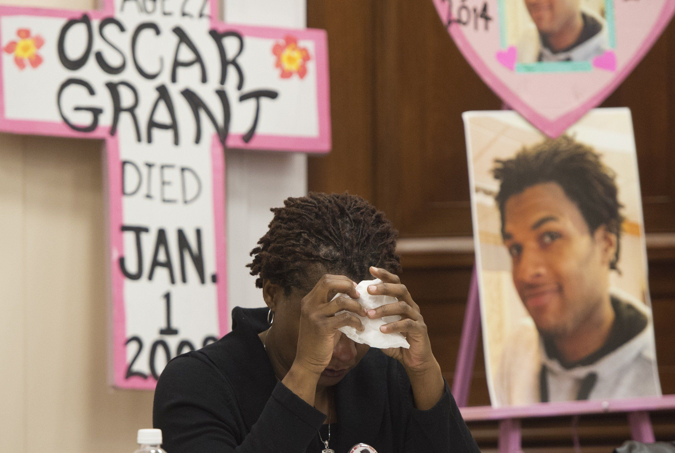 Tressa Sherrod cries after telling the story of her son, John Crawford III, who was shot and killed by police in an Ohio Walm