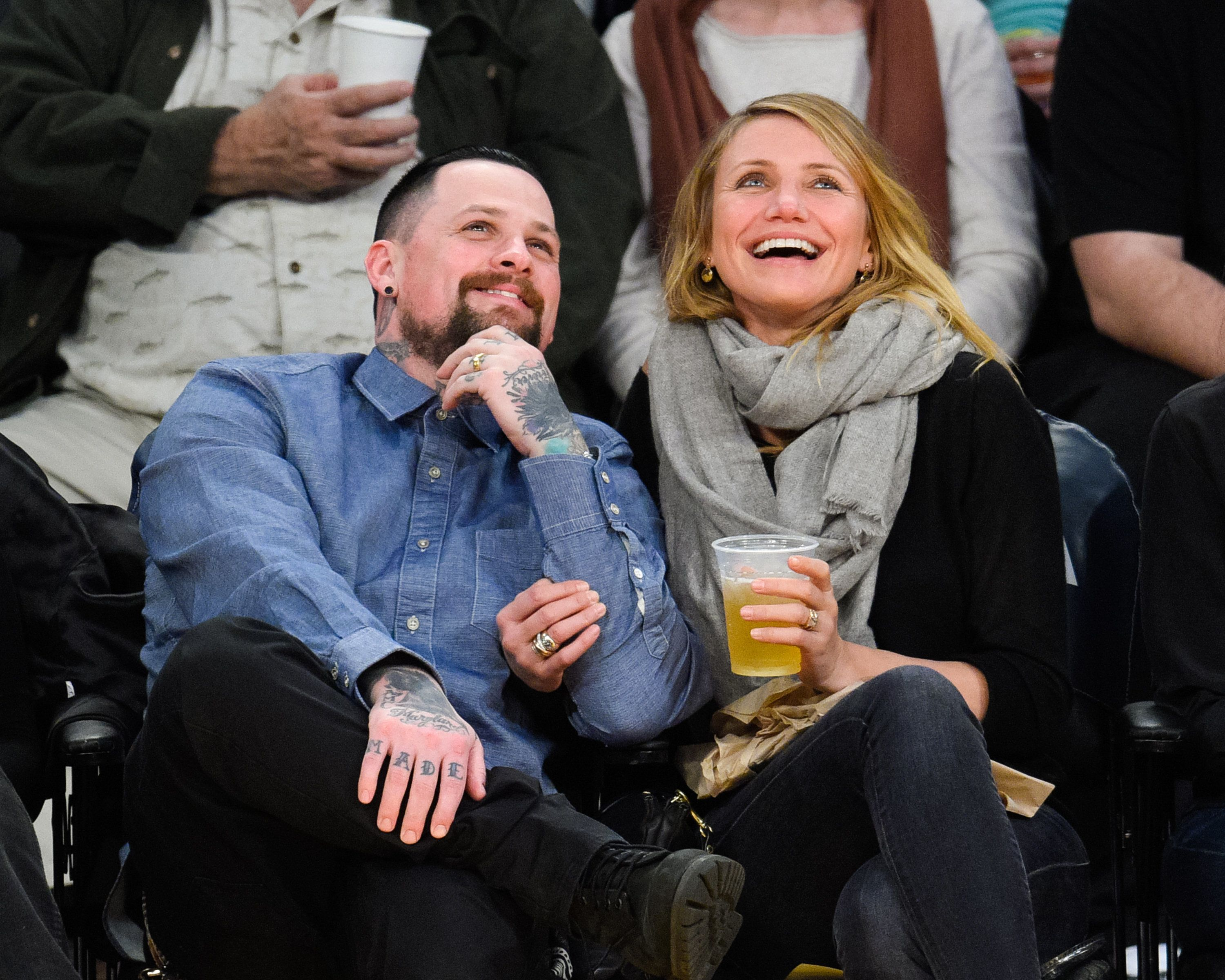 LOS ANGELES, CA - JANUARY 27:  Benji Madden (L) and Cameron Diaz attend a basketball game between the Washington Wizards and the Los Angeles Lakers at Staples Center on January 27, 2015 in Los Angeles, California.  (Photo by Noel Vasquez/GC Images)