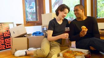 Couple eating and moving into new apartment