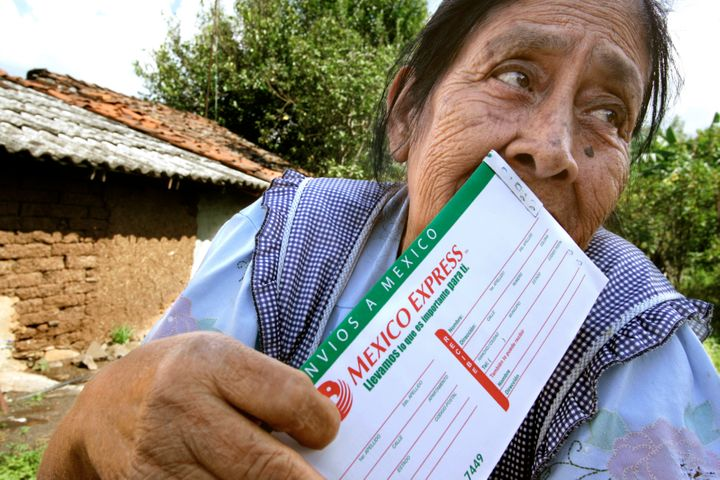 Guadalupe Vidales, 74, kisses the Mexico Express money order that just arrived from her son in Bakersfield, California. There