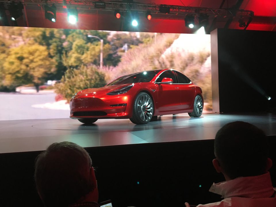 A Tesla Model 3 sedan, the first car aimed at the mass market from the company led by CEO Elon Musk, is displayed during its