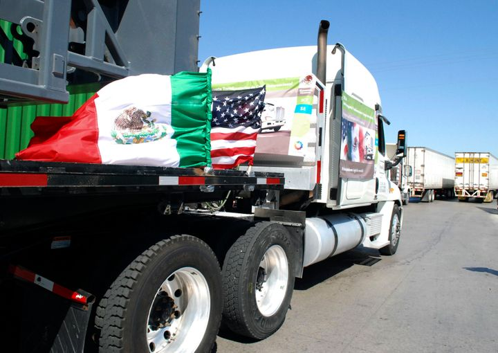 A truck flying Mexican and U.S. flags approaches the border crossing in Laredo, Texas, on Oct. 21, 2011. Trump's proposal to