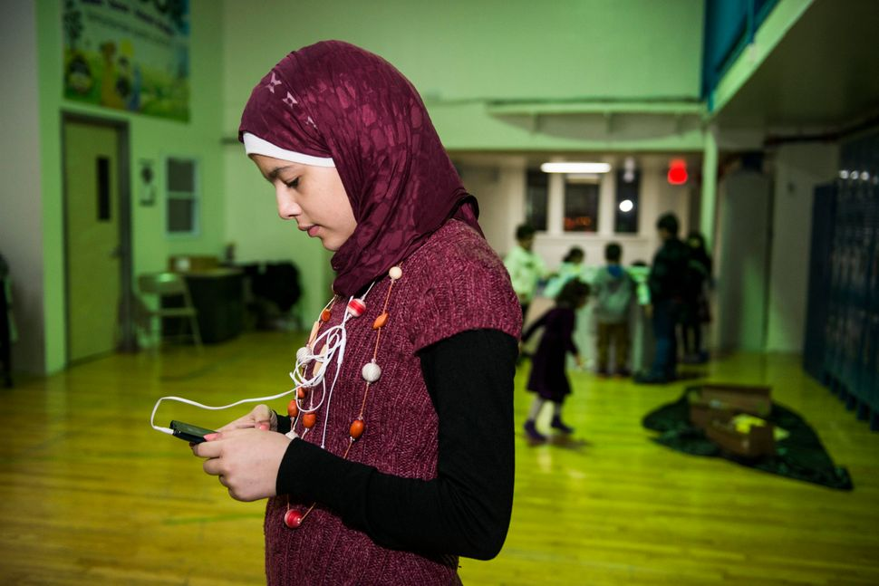 Nabiha, 13, spends an inordinate amount of time on her smartphone, listening to music by Adele or by Syrian singers and chatt