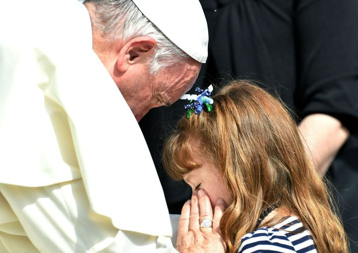 Pope Francis blesses the eyes of Lizzy Myers, a 5-year-old American girl who will likely lose her vision due to a rare condit