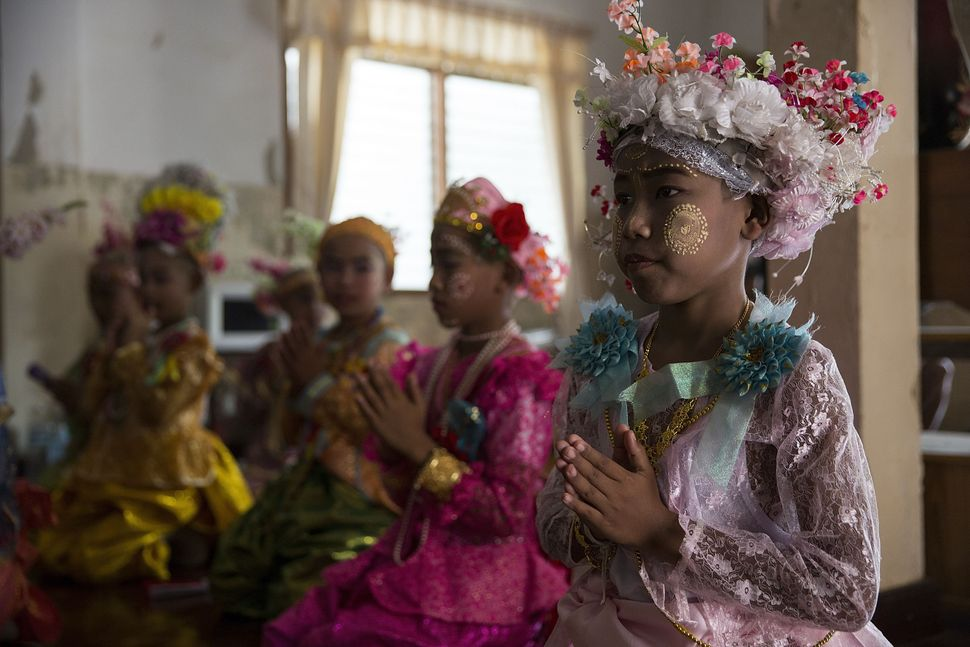 Kemachart and other novices take part in a prayer ceremony at a shrine near Wat Supan Rangsri on April 6.