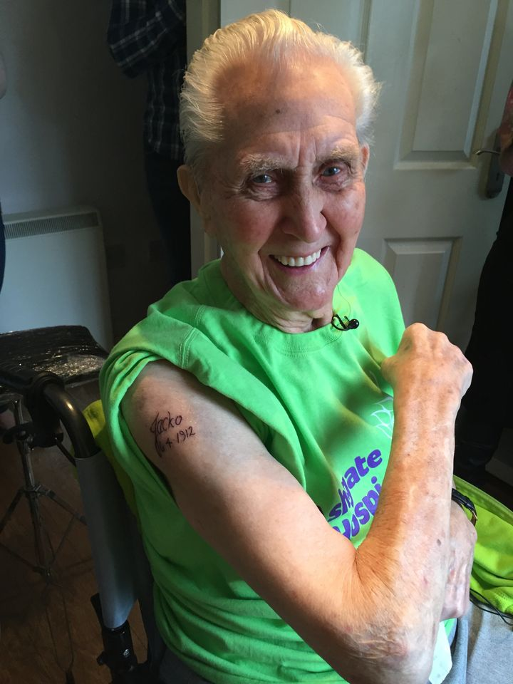 Jack Reynolds, shows off his first tattoo which he got at age 104.