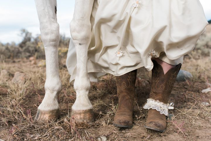 The bride and one of the horses showing off their hooves.