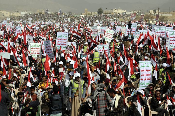 Yemenis protest Saudi-led airstrikes during a rally on the first anniversary of the conflict.