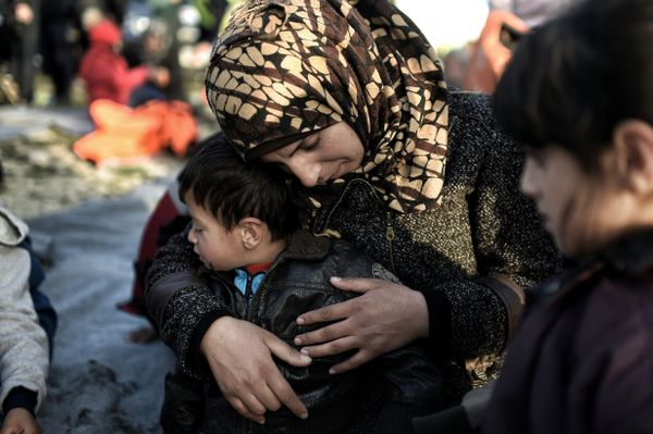 A woman hugs a boy after arriving to Lesbos on Feb. 29, 2016.