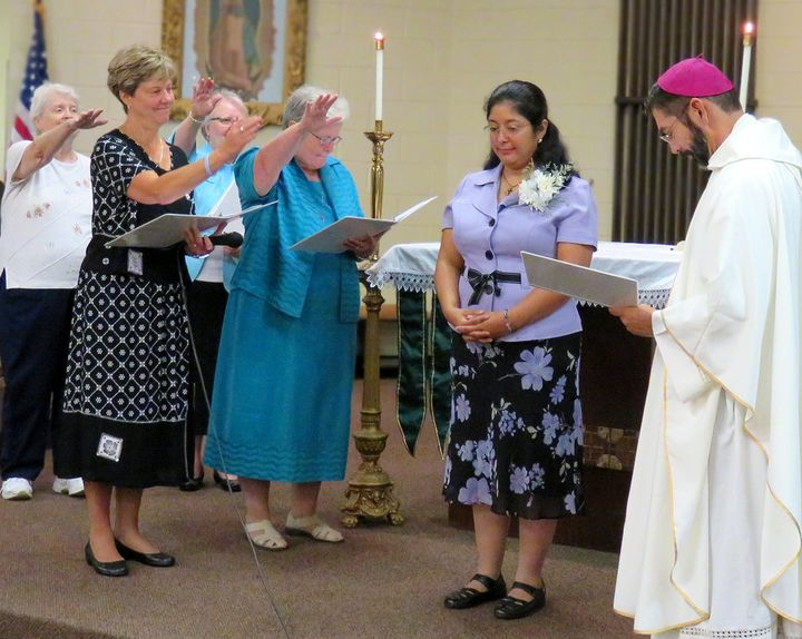 Sister Claudia Canoreceives a blessing from her community.