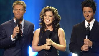Ryan Seacrest, Kelly Clarkson & Brian Dunkleman (Photo by SGranitz/WireImage)