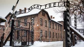 Arbeit macht frei sign at Auschwitz Concentration Camp, a UNESCO World Heritage Site, Oswiecim near Krakow, Poland, Europe.