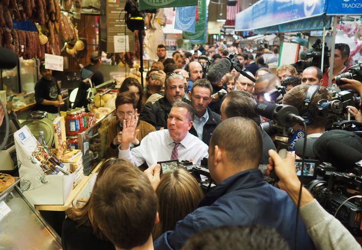 Journalists swarmed around John Kasich while he ate at a Bronx deli this week, part of an unusual presidential media frenzy e