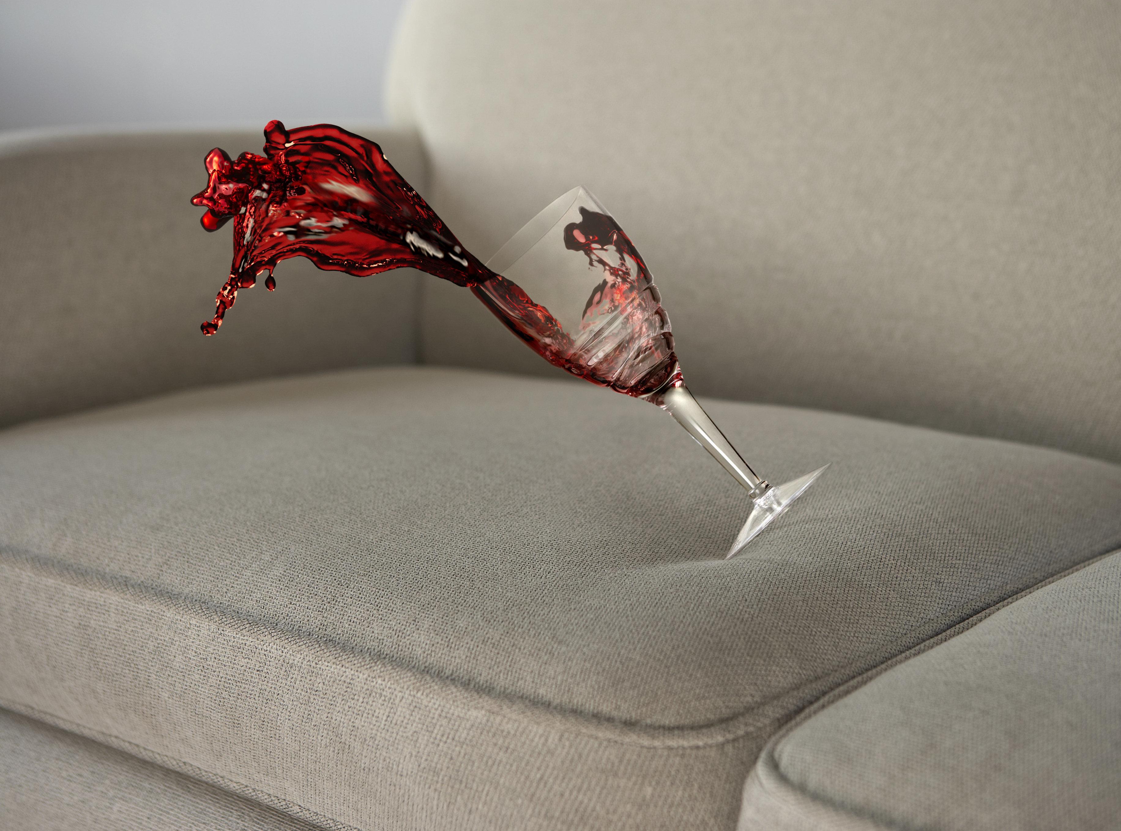 red wine splashing onto sofa