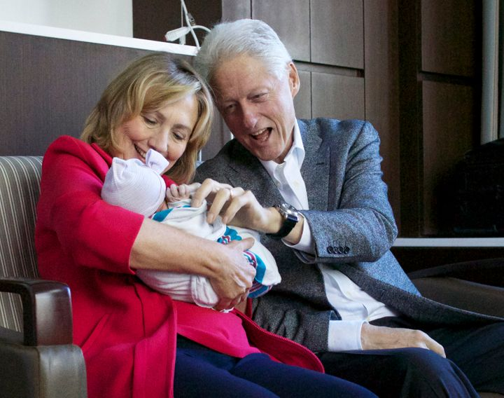 Bill and Hillary Clinton with their first grandchild, Charlotte Clinton Mezvinsky.