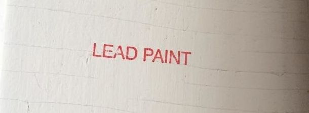 """The words """"Lead Paint"""" are stamped on thewall of an apartment where New York City health department inspectors found pe"""