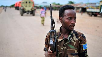 A member of the Somali National Army (SNA) patrols Wanla Weyn, three weeks after the town was liberated by AMISOM forces from Al-Shabab October 27, 2012. AMISOM forces have now passed through the town and are currently moving further up the road in an effort to gain control of the road to Baidoa. REUTERS/Tobin Jones/AU-UN IST PHOTO/Handout (SOMALIA - Tags: CIVIL UNREST SOCIETY) FOR EDITORIAL USE ONLY. NOT FOR SALE FOR MARKETING OR ADVERTISING CAMPAIGNS. THIS IMAGE HAS BEEN SUPPLIED BY A THIRD PARTY. IT IS DISTRIBUTED, EXACTLY AS RECEIVED BY REUTERS, AS A SERVICE TO CLIENTS. MANDATORY CREDIT