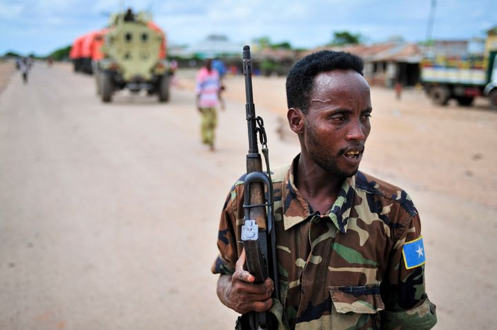 A Somali soldierpatrols a town captured from al Shabab. The Islamist militant group is trying to disrupt Somalia's poli