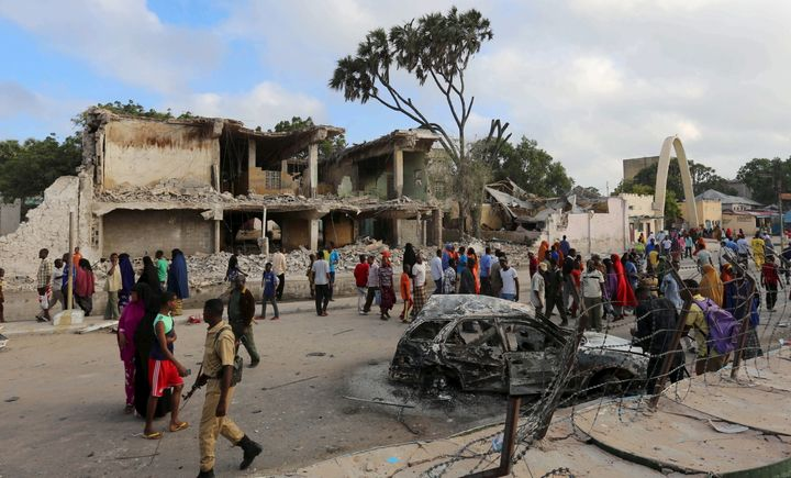 Residents view the damage after a car bombing at a hotel in Mogadishu inFebruary 2016. Al Shabab has stepped up attacks