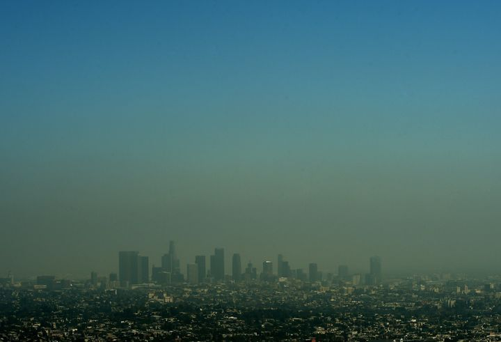 The Los Angeles skyline rich with smog coversone of the biggest ports in America.