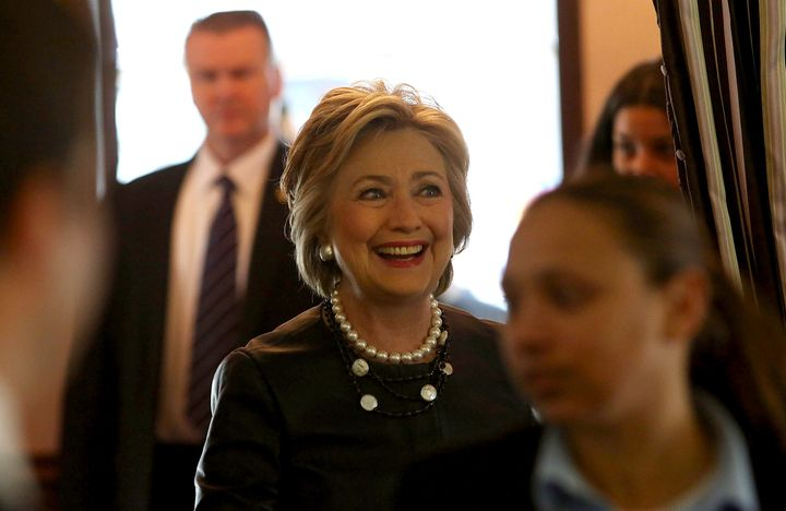 Hillary Clinton enters Make My Cake in Harlem.