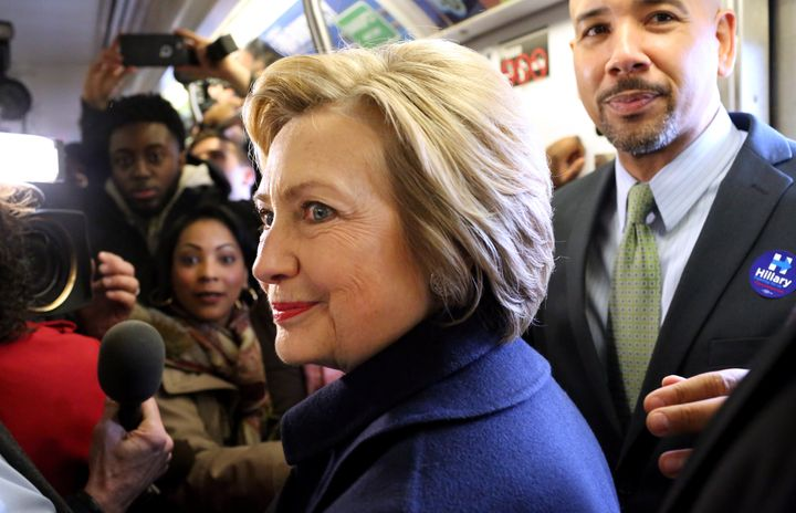 Hillary Clinton rides the subway in New York City.