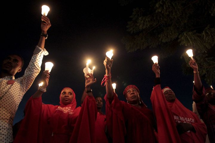 Bring Back Our Girls campaigners hold candles at a rally for the Chibok girls last August. It has been two years since n