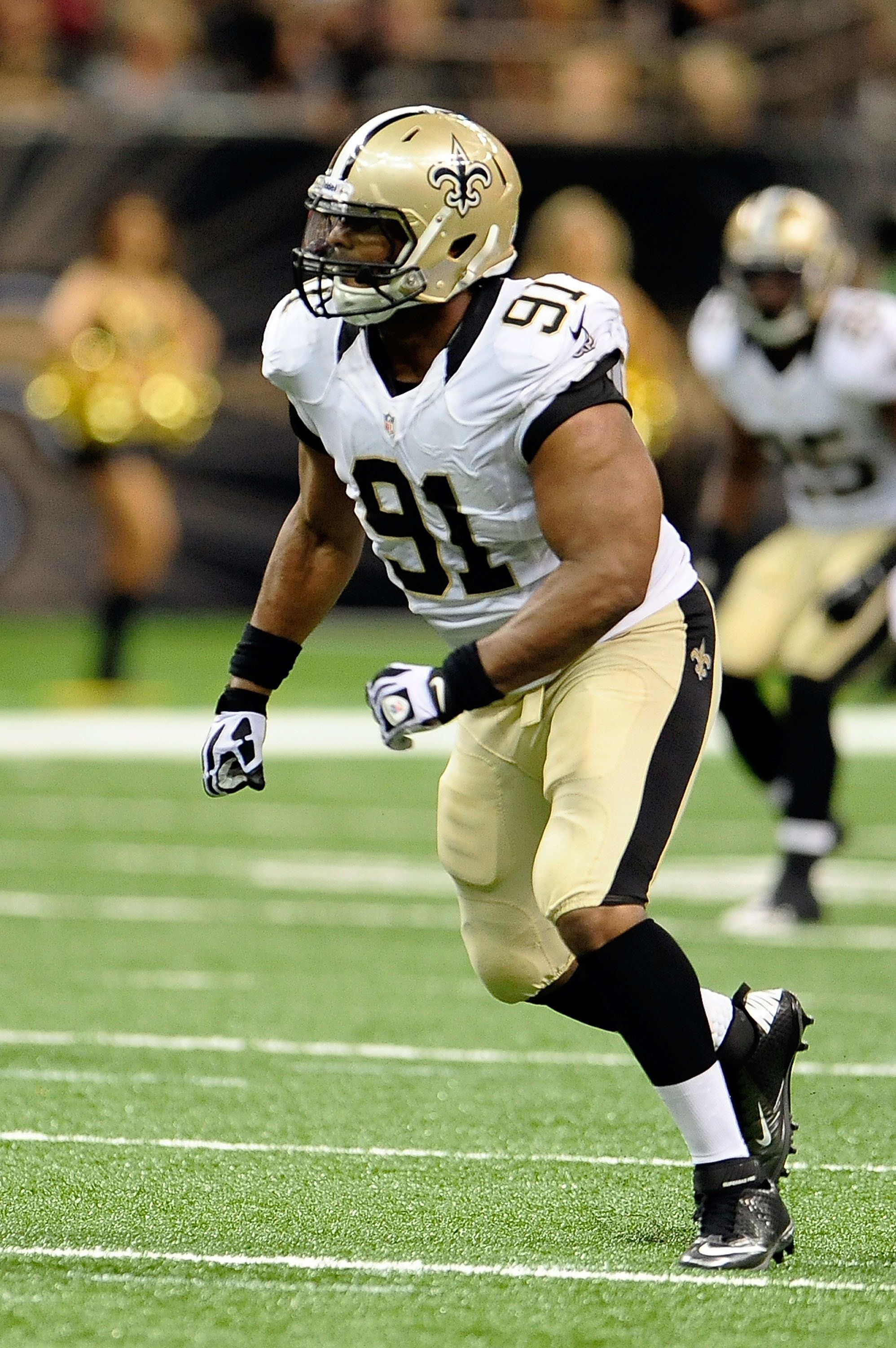 NEW ORLEANS, LA - AUGUST 16:  Will Smith #91 of the New Orleans Saints anticipates a play during a preseason game against the Oakland Raiders at the Mercedes-Benz Superdome on August 16, 2013 in New Orleans, Louisiana.  The Saints won 28-20.  (Photo by Stacy Revere/Getty Images)