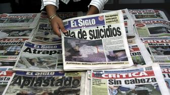 Photo shows the front pages of Panama's two biggest-selling dailies, La Critica and El Siglo, which carry violent images of accidents and murders, in Panama City July 15, 2002. Despite the popularity of the papers, Panama is preparing to pass a law to monitor which photos may be published in newspapers. Press freedom groups say the move is a thinly disguised way to limit freedom of the press in Panama. REUTERS/Alberto Lowe/FEATURE/MEDIA-PANAMA  AL/HB