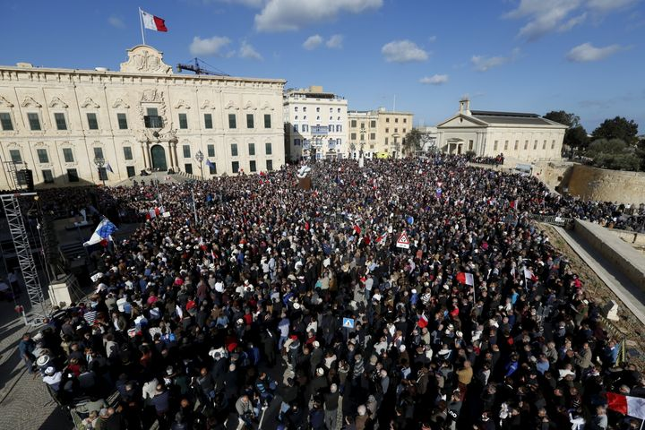 Protesters take part in a demonstration calling on Maltese Prime Minister Joseph Muscat to resign after two members of his go
