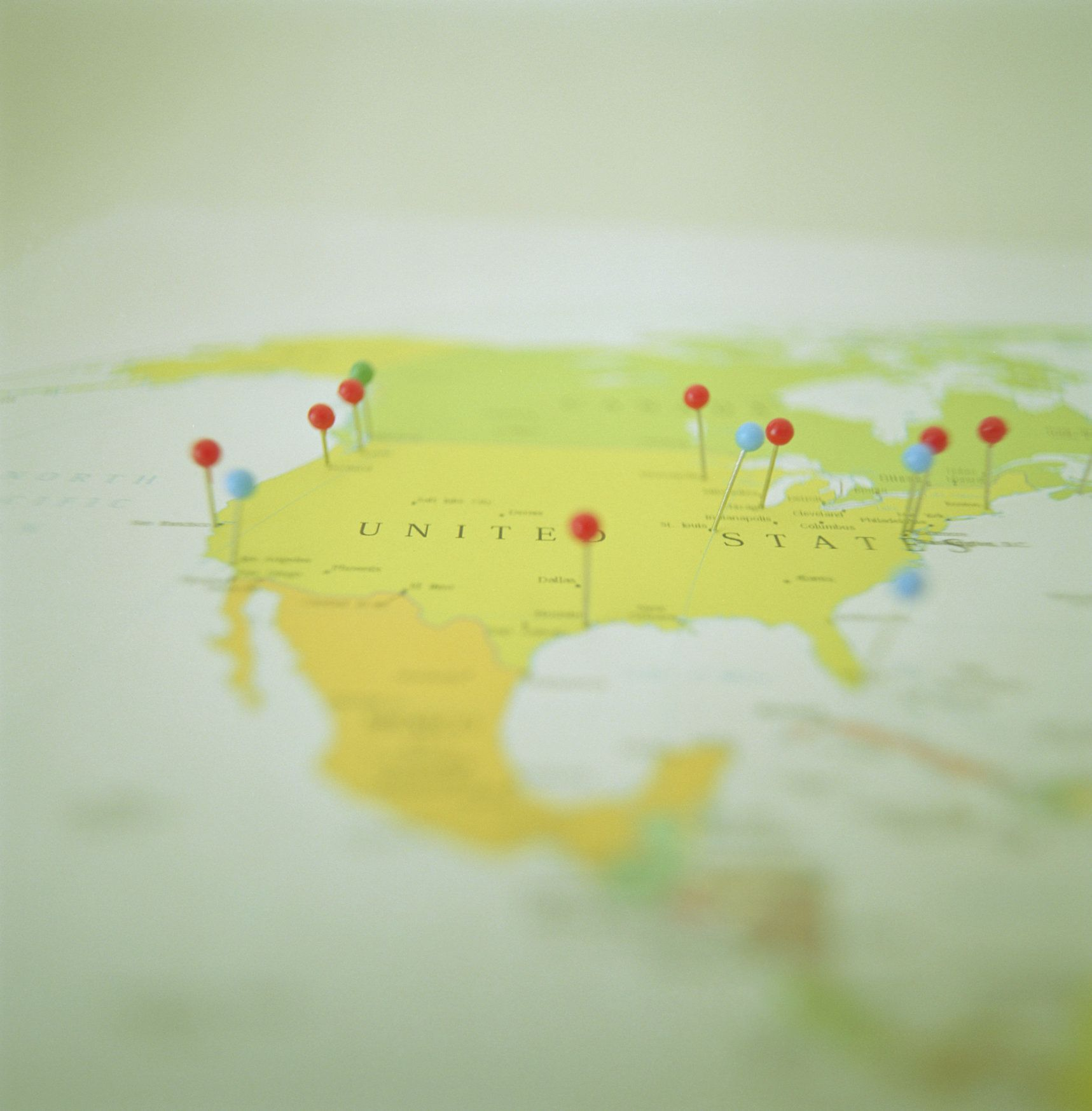Stickpins marking cities on map, surface level