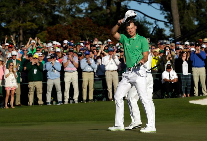 Apr 10, 2016; Augusta, GA, USA; Danny Willett waves to the crowd after completing the 18th hole during the final round of the