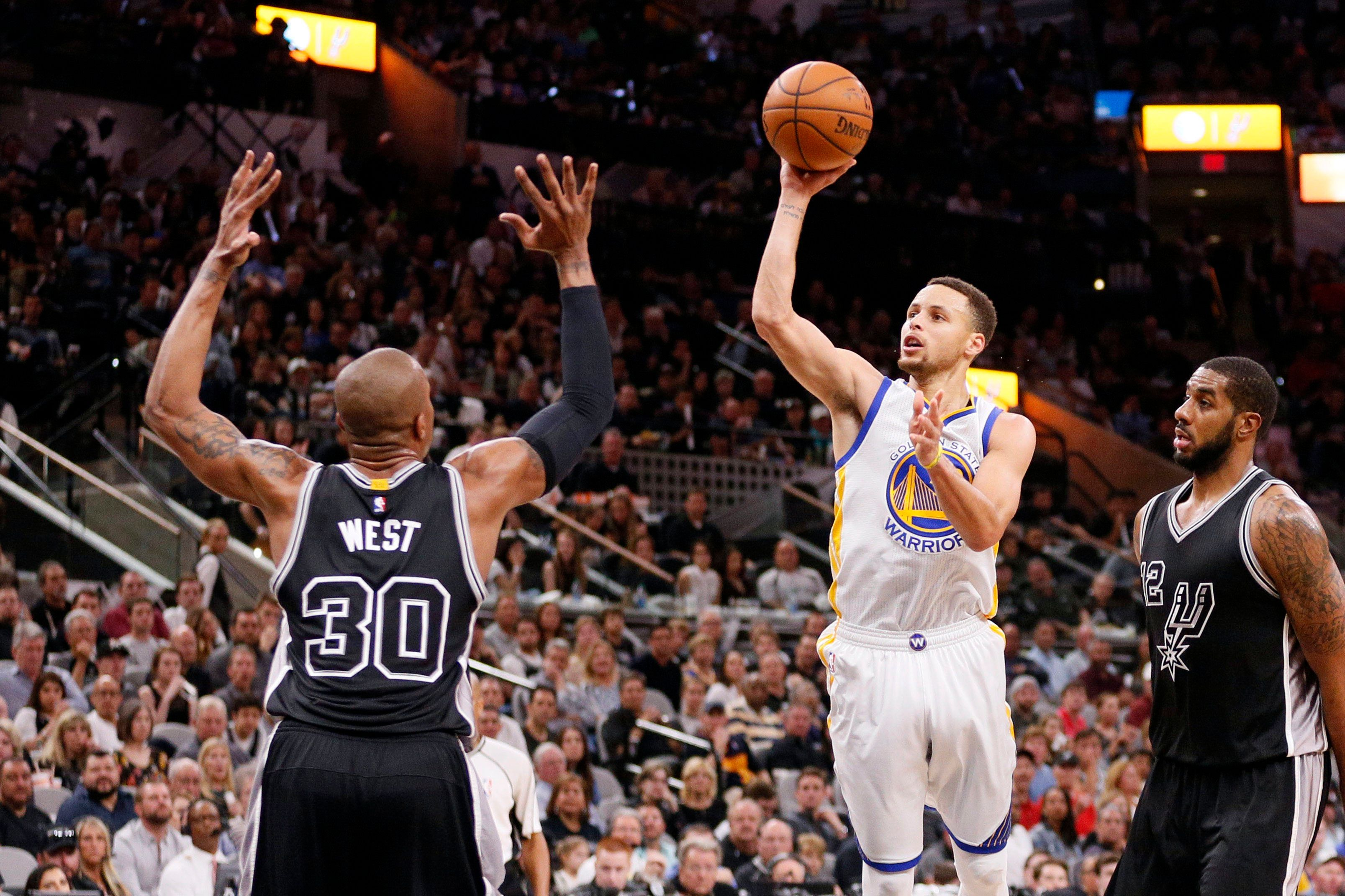 Apr 10, 2016; San Antonio, TX, USA; Golden State Warriors point guard Stephen Curry (30) shoots the ball over San Antonio Spurs power forward David West (30) during the second half at AT&T Center. Mandatory Credit: Soobum Im-USA TODAY Sports