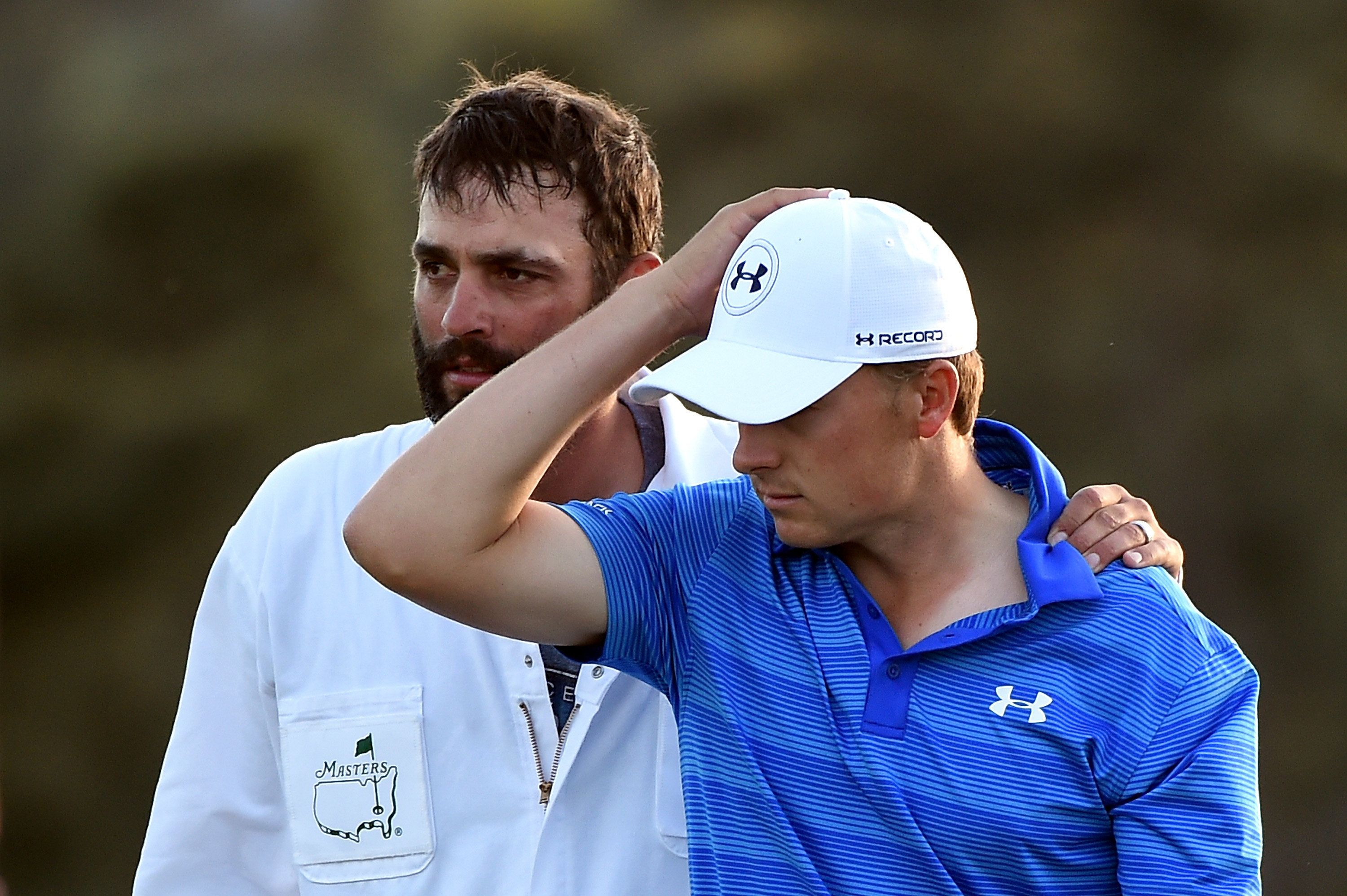 AUGUSTA, GEORGIA - APRIL 10:  Jordan Spieth of the United States and caddie Michael Greller react after finishing on the 18th green during the final round of the 2016 Masters Tournament at Augusta National Golf Club on April 10, 2016 in Augusta, Georgia.  (Photo by Harry How/Getty Images)