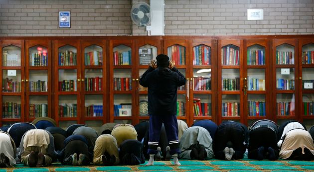Men pray at the Birmingham Central Mosque on visit my mosque day in