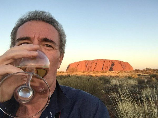 Michael Pattemore enjoys a glass of wine at Ayres Rock in