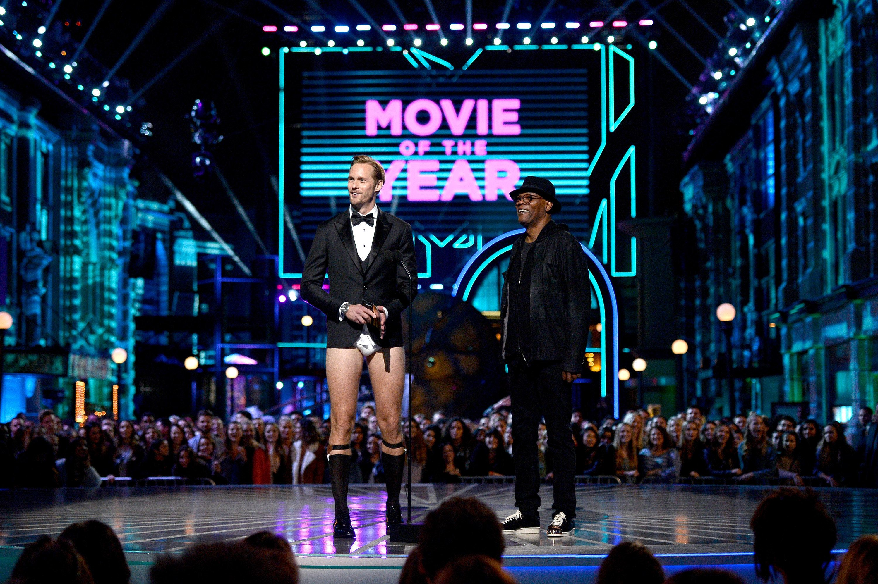 BURBANK, CALIFORNIA - APRIL 09:  Actors Alexander Skarsgard (L) and Samuel L. Jackson speak onstage during the 2016 MTV Movie Awards at Warner Bros. Studios on April 9, 2016 in Burbank, California.  MTV Movie Awards airs April 10, 2016 at 8pm ET/PT.  (Photo by Kevork Djansezian/Getty Images)