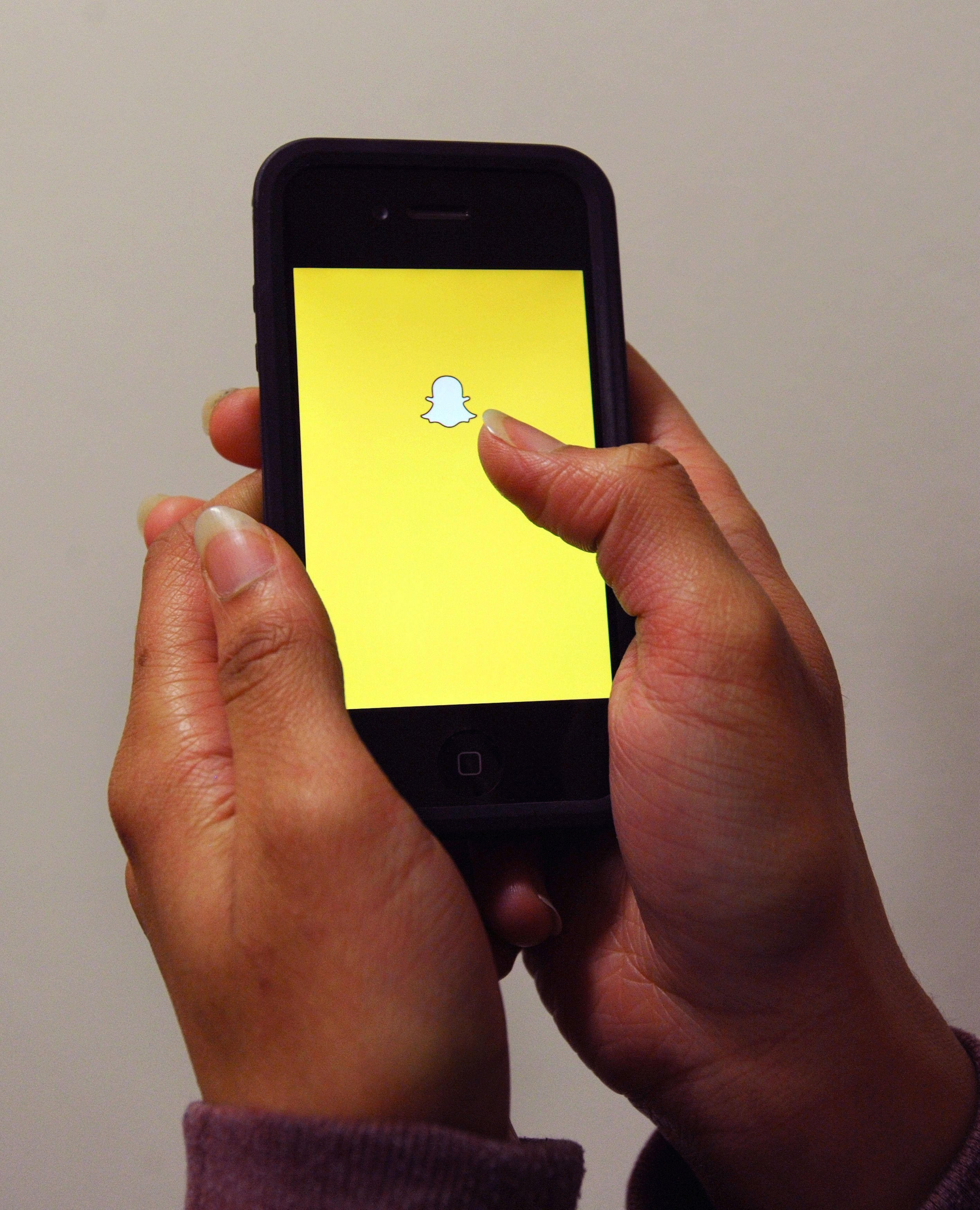 File photo dated 30/01/15 of the Snapchat App logo as the photo messaging service Snapchat is down for many users in the UK and around the world, with the company confirming it is working to fix the problem.