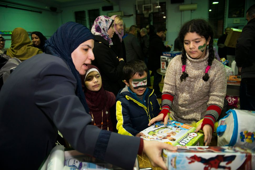 Amira and her children choose among donated toys and household items.
