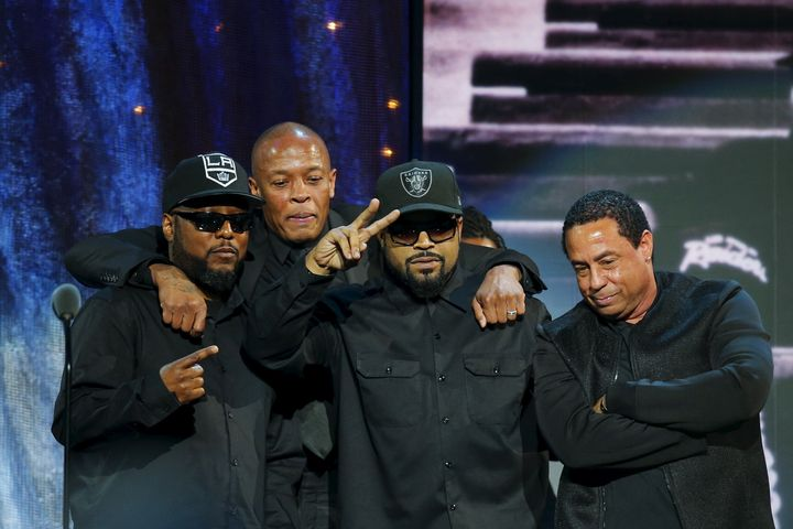 (L-R) MC Ren, Dr. Dre, Ice Cube and DJ Yella of N.W.A. pose for a picture onstage after speaking at the 31st annual Rock and