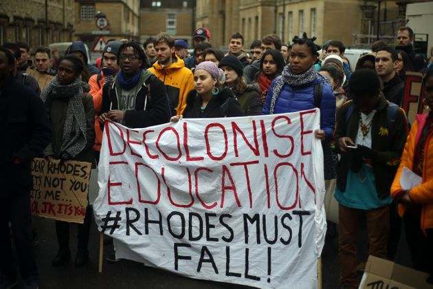 Students march through Oxford as part of the #RhodesMustFall campaign in March