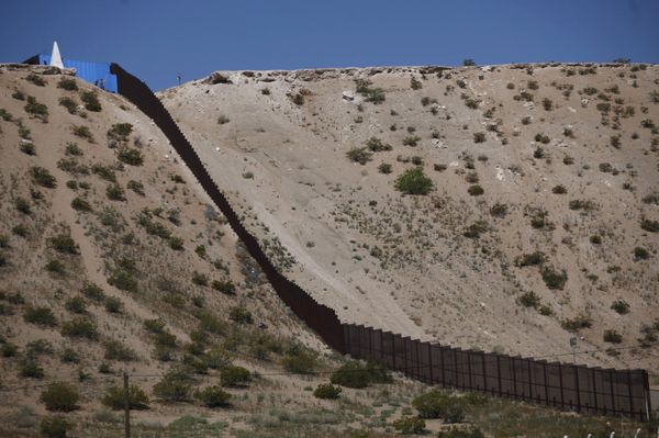 Part of the border fence is seen in Ciudad Juárez after artist Ana Teresa Fernandez and Border/Artevolunteers&nb
