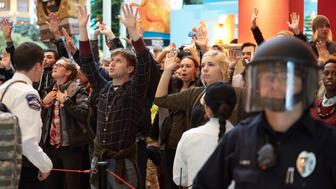 BLOOMINGTON, MN - DECEMBER 20: Thousands of protesters from the group 'Black Lives Matter' disrupt holiday shoppers on December 20, 2014 at Mall of America in Bloomington, Minnesota. (Photo by Adam Bettcher/Getty Images)