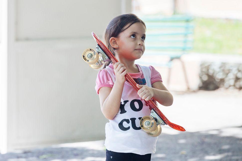 """A little girl wearing a""""Yo (heart) Cuba"""" shirt by Amigo Skate Cuba. (All Photos are Copyright of<a href=""""ht"""