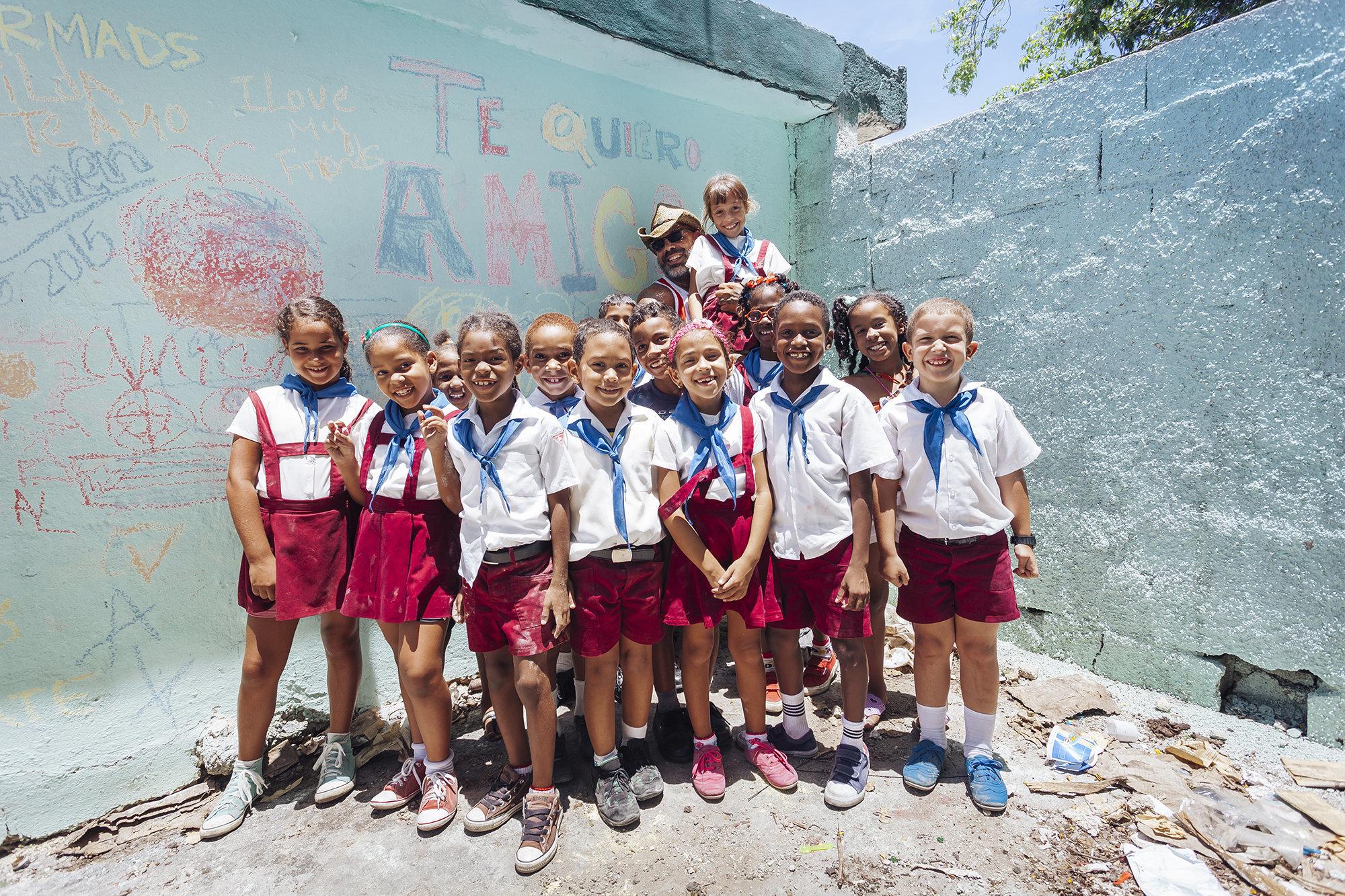 """Rene Lecour, founder of <a href=""""http://www.amigoskate.com/#amigo"""">Amigo Skate</a>, with the school children. (All Photos are"""