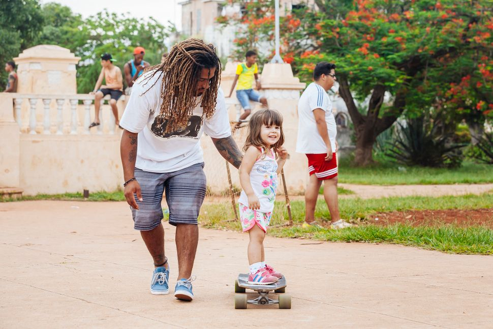 "A little girl learns to ride a skateboard. (All Photos are Copyright of&nbsp;<a href=""https://www.instagram.com/emmy_park/"" t"