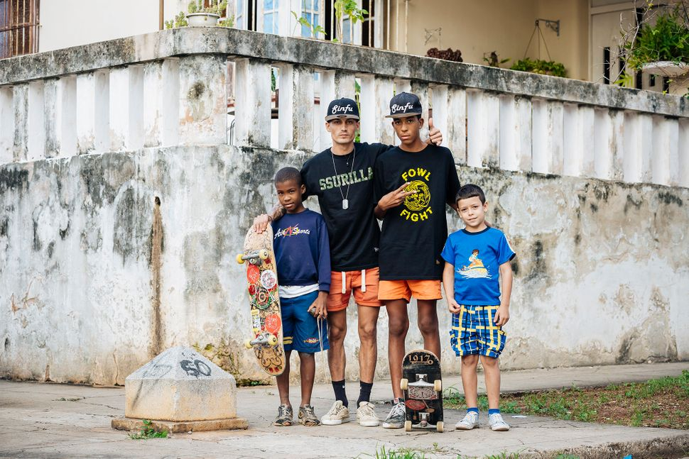 "Raidel Perez Gonsalez and Onay Alejandro with neighborhood children wearing t-shirts donated by <a href=""http://www.ssur.com/"