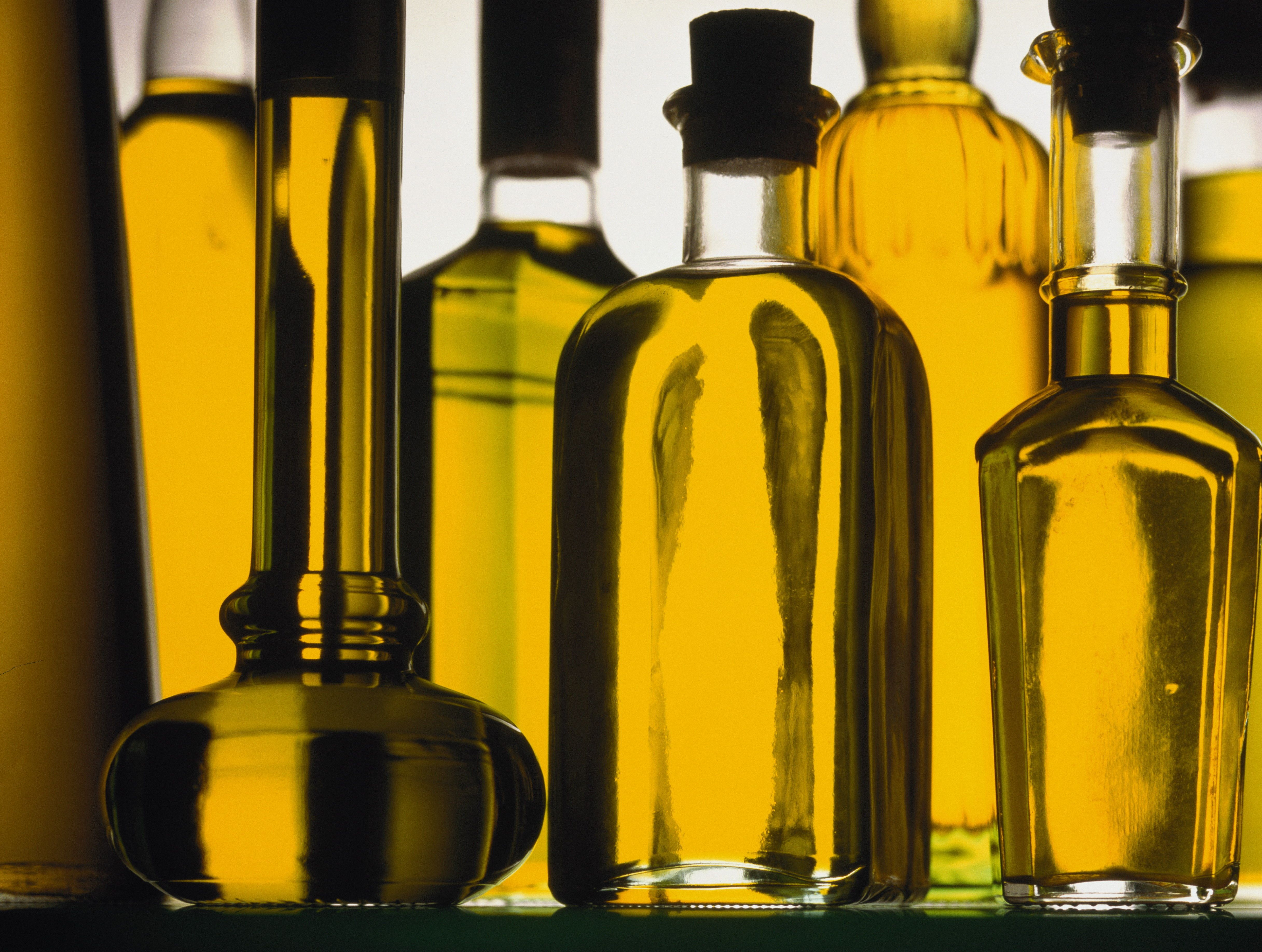 Glass bottles filled with cooking oil, close-up