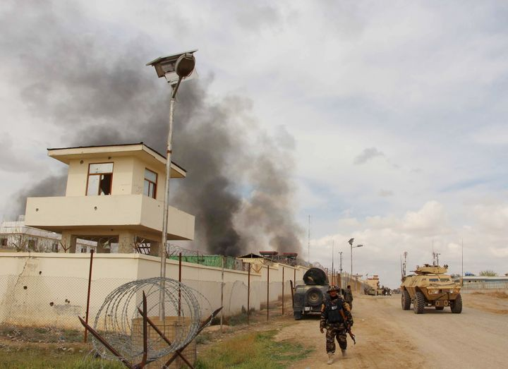 Smoke billows from a building after a Taliban attack in the Gereshk district of Helmand province, Afghanistan.